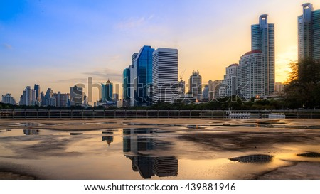 Bangkok city sunrise reflection river of sun. Panoramic view light blue background of glass high rise building skyscraper commercial of future. Business concept of success industry tech architecture - stock photo