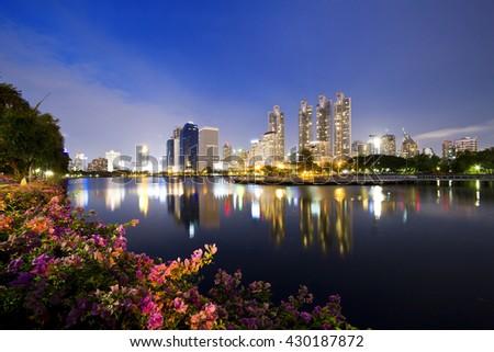 Bangkok city view at night,View the city from Benchakitti Park in Bangkok - stock photo