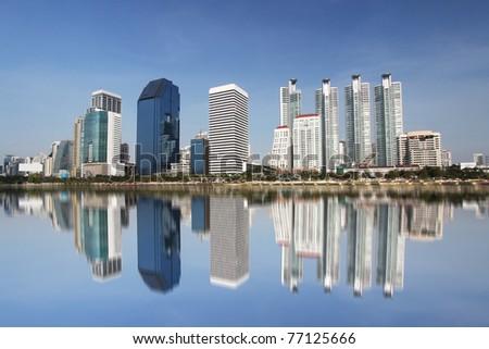 Bangkok city view with the reflection, taken from Benjakitti park on Ratchadapisek Road in Bangkok, Thailand - stock photo