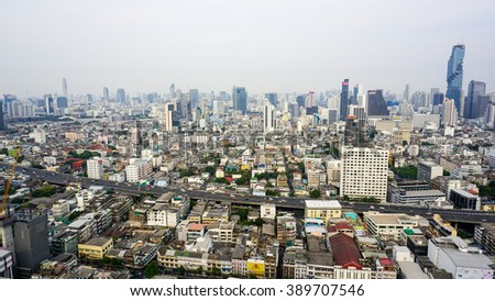 Bangkok cityscape from the rooftop on gloomy day near Bangrak District, Bangkok. Shot taken on March 10, 2016