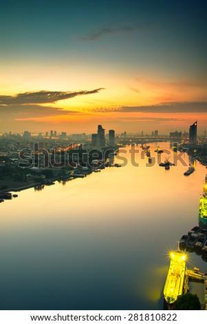 Bangkok Cityscape near river in morning - stock photo