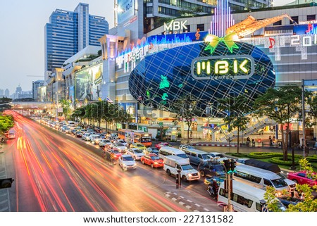Bangkok - DEC 13 :  MBK's shopping mall at dusk, welcome to Christmas and Happy New Year 2014 festival on December 13,2013 at Bangkok, Thailand - stock photo