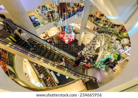 BANGKOK - DEC 30: People shop at Central World on Dec 30, 2013 in Bangkok, Thailand. It is a shopping plaza and complex in Bangkok which is the sixth largest shopping complex in the world. - stock photo