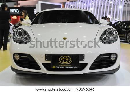 BANGKOK - DEC 12: Porsche Caymen on display at the Thailand International Motor Expo at Impact Muang Thong Thani on Dec 12, 2011 in Bangkok, Thailand. - stock photo