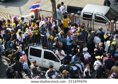 BANGKOK - DEC 21: Protesters surround a police station during a large anti government rally on Dec 21, 2013 in Bangkok, Thailand. Protesters call for political reform. - stock photo