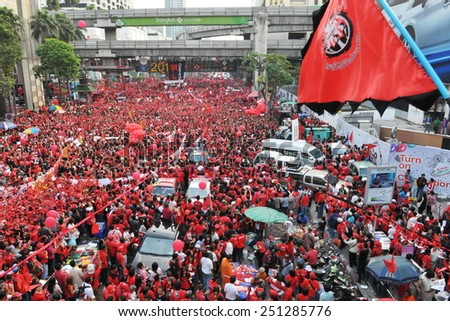 BANGKOK - DEC 19: Red Shirt protesters rally in the city centre on Dec 19, 2010 in Bangkok, Thailand. Protesters gathered to mark 6 months since a violent military crackdown on the protest group. - stock photo