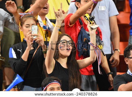 BANGKOK, DEC 10:Unidentified Thai fans cheer after the competition 2014 AFF Suzuki Cup between Thailand and Philippines at Rajamangala stadium on December 10, 2014 in Bangkok, Thailand.  - stock photo
