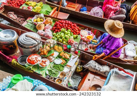 BANGKOK-DECEMBER 13: floating market Damnoen Saduak with unidentified people on December 13, 2014 in Bangkok, Thailand. The market that is a great tourist attraction located on a Khlong in Thailand - stock photo