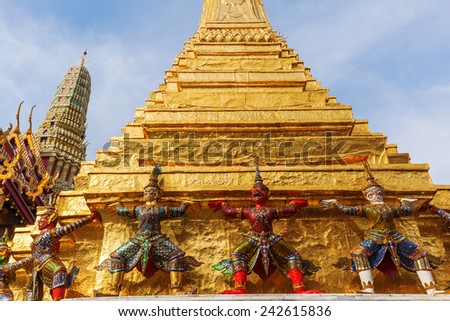 BANGKOK - DECEMBER 16: Golden Chedi at the temple Wat Phra Kaew on December 16, 2014 in Bangkok. Wat Phra Kaew or Wat of the Emerald Buddha is regarded as the most sacred Buddhist temple in Thailand - stock photo