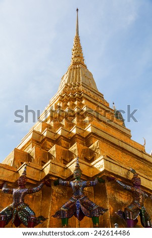 BANGKOK - DECEMBER 16: golden Chedi at Wat Phra Kaew on December 16, 2014 in Bangkok. Wat Phra Kaew or Wat of the Emerald Buddha is regarded as the most sacred Buddhist temple in Thailand - stock photo