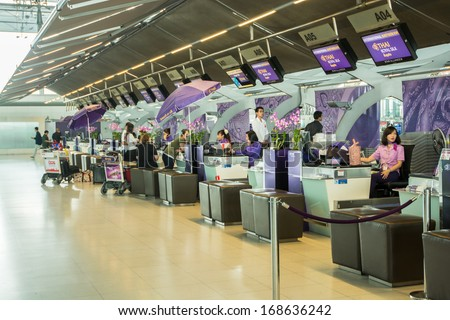 BANGKOK-DECEMBER 16:Passengers at international check in desk on business class by Thai airways in Suvarnabhumi Airport on December 16, 2013 in Bangkok,Thailand. - stock photo