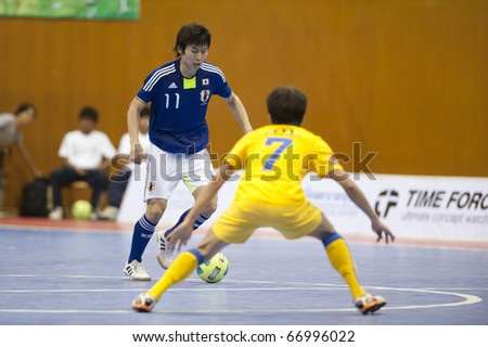 BANGKOK - DECEMBER 11 : Thailand vs Japan, Bangkok Futsal Super Match 2010,Kritsada Wongdaeo (R) and Kazuhiro Nibuya (L) on DECEMBER 11 -12, 2010 in Bangkok Thailand.
