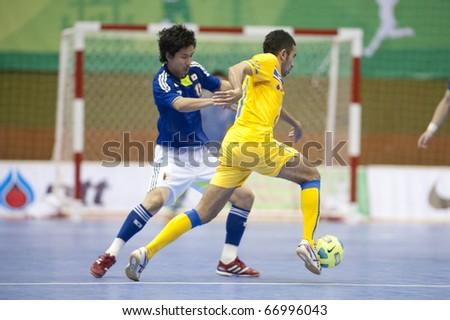 BANGKOK - DECEMBER 11 : Thailand vs Japan, Bangkok Futsal Super Match 2010,Suphawut Tompa (R) and Mitsuyoshi Matsumiya (L) on DECEMBER 11 -12, 2010 in Bangkok Thailand. - stock photo