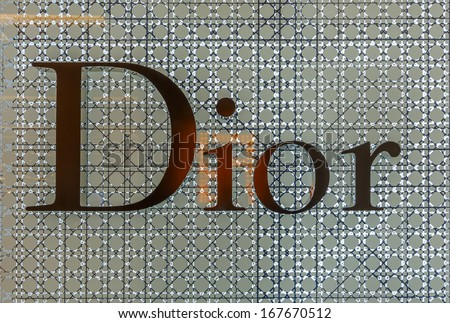 BANGKOK - DECEMBER 5: The sign of Dior at Dior store on Dec 5, 2013 in Siam Paragon Bangkok, Thailand. It is a French company controlled and chaired by Bernard Arnault who also heads Louis Vuitton. - stock photo