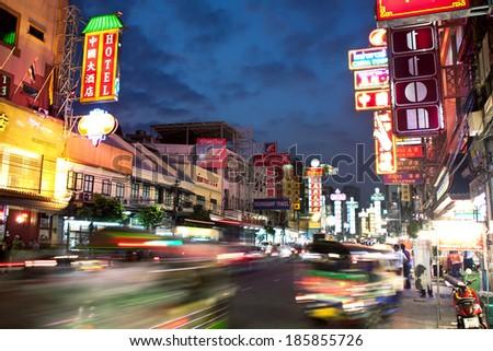 BANGKOK - DECEMBER 19: Traffic jam at evening on Yaowarat Road December 19, 2013 in Bangkok. Thailand. Yaowarat Road is a main street in Bangkok's Chinatown, it was opened in 1891 in reign of Rama V. - stock photo