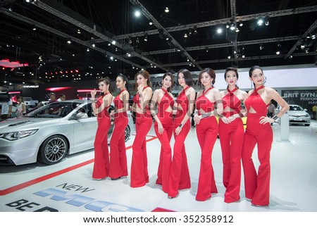 BANGKOK - DECEMBER 12, 2015 : Unidentified model with MG car on display at The 32nd Bangkok International Motor Expo on DECEMBER 12, 2015 in Bangkok, Thailand.