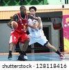 "BANGKOK - FEB13:Gabriel Freeman #25 participates in an ASEAN Basketball League ""ABL"" at Nimitbut Stadium on February 13, 2013 in Bangkok,Thailand.SMB beat CTS 77-73 - stock photo"