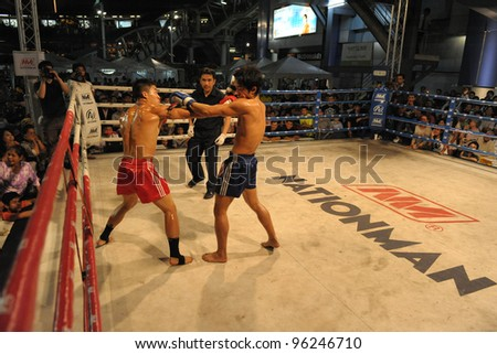 BANGKOK - FEB 22: Unidentified Muay Thai fighters compete in a Thai kickboxing match at MBK Fight Night on Feb 22, 2012 in Bangkok, Thailand. - stock photo