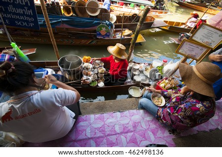 BANGKOK-FEBRUARY 11: floating market Damnoen Saduak with unidentified people on February 13, 2011 in Bangkok, Thailand. The market that is a great tourist attraction located on a Khlong in Thailand.