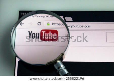 BANGKOK-FEBRUARY 25 2015: Magnifying Youtube Icon on Tablet. YouTube is a video-sharing website headquartered in San Bruno, California. - stock photo
