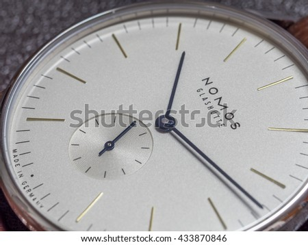BANGKOK - FEBRUARY 5: Nomos watch is Germany watch brand, clean design, luxury watch with winding machine, white dial and brown alligator strap was taken on February 5, 2016, in Bangkok, Thailand.