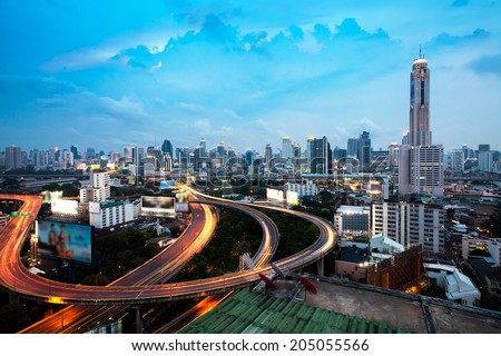 Bangkok Highway at Dusk with skyline in Thailand  - stock photo