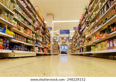 BANGKOK - JAN 29: Low angle aisle view in a Tesco store on Jan 29, 2013 in Bangkok, Thailand. Britain's Tesco is the world's third largest retailer after America's Walmart and France's Carrefour. - stock photo