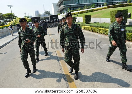 BANGKOK - JAN 27: Soldiers deploy during an anti government rally at a city centre military facility on Jan 27, 2014 in Bangkok, Thailand. The Thai capital has seen months of political instability. - stock photo