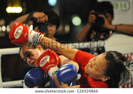 BANGKOK - JAN 23: Unidentified fighters compete in an amateur Thai Kickboxing, or Muay Thai, match at MBK Fight Night on Jan 23, 2013 in Bangkok, Thailand. Muay Thai is the national sport of Thailand. - stock photo