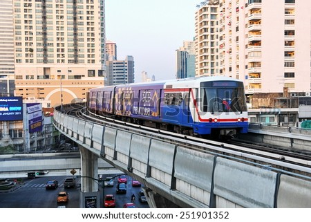 BANGKOK - JAN 7: View of a BTS Skytrain on elevated rails in the city centre Jan 7, 2011 in Bangkok, Thailand. The Thai capital's mass public transport rail network carries 600,000 passengers daily. - stock photo