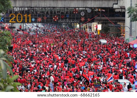 BANGKOK - JANUARY 9: 30,000 anti government Red Shirts protest at Rachaprasong junction on January 9, 2011 in Bangkok, Thailand. The Red Shirts are calling for political change and fresh elections. - stock photo