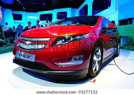 BANGKOK - JANUARY 19:   Chevrolet Volt, electronic power car from General motor, being displayed at 6th BOI FAIR 2012 on January 19, 2012 in Bangkok, Thailand. The event is from Jan. 6-22, 2012. - stock photo