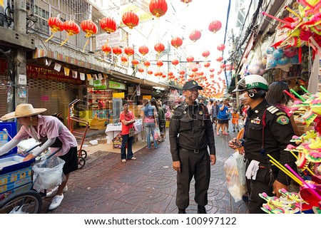 BANGKOK - JANUARY 22: China town street policemen during the Chinese New Year celebrations on January 22, 2012 in Bangkok, Thailand.