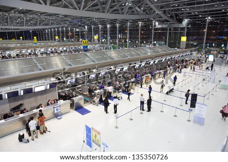 BANGKOK JANUARY 17. People waiting in check-in line G terminal of the Bangkok airport on January 17, 2012. Suvarnabhumi airport is world's 4th largest single-building airport terminal. - stock photo