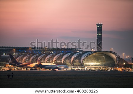 BANGKOK-January 2: Suvarnabhumi Airport at sunset on January 2, 2016 in Bangkok ,Thailand. This airport is the world's third largest single building airport terminal designed by Helmut Jahn. - stock photo