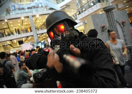 BANGKOK - JUL 22: A cosplayer dressed as a soldier joins a city centre cosplay meet on Jul 22, 2012 in Bangkok, Thailand. Thai cosplayers regularly meet in Bangkok's shopping districts and malls. - stock photo
