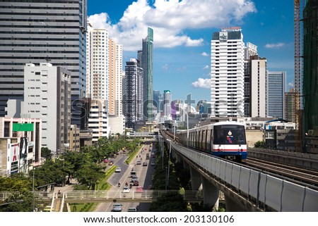 BANGKOK - July 6: A BTS Skytrain on elevated rails in Sathorn district on July 6, 2014 in Bangkok, Thailand. Each train of the mass transport rail network can carry over 1,000 passengers. - stock photo