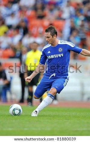 BANGKOK - JULY 24 : F.Lampard in action during Coke Super Cup :Chelsea Asia Tour 2011 Thailand. TPL All Star between Chelsea at Rajamangla Stadium ,July 24, 2011 in Bangkok, Thailand. - stock photo