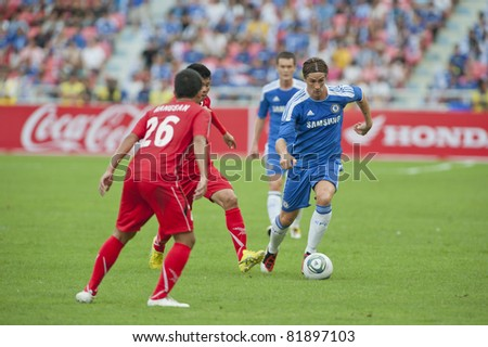 BANGKOK - JULY 24 : F.Torres (B) in action during Coke Super Cup : Chelsea  Asia Tour 2011 (Thailand),  between Chelsea vs Thail  All-Star on July 24, 2011 in Rajamangla Stadium, Bangkok, Thailand. - stock photo