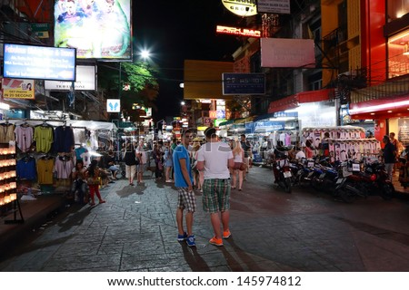 BANGKOK - JULY 14: Unidentified tourists and backpackers walk along  Khao San Road on July 14, 2013 in Bangkok, Thailand. Khao San Road is famous place for backpackers with low budget. - stock photo