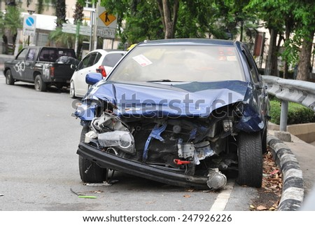 BANGKOK - JUN 5: A crashed car sits by a roadside on Jun 5, 2013 in Bangkok, Thailand. According to Dept of Land Transport statistics Bangkok saw 27166 road vehicle accidents between 2011 and 2012. - stock photo
