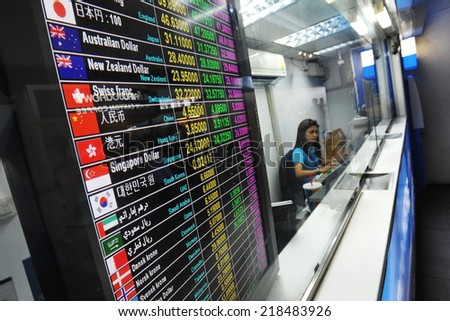 BANGKOK - JUN 9: View of tourist exchange rates at a streetside booth as the Thai Baht falls for the 7th week on Jun 9, 2013 in Bangkok, Thailand. The Baht has fallen as foreign investors cash out. - stock photo