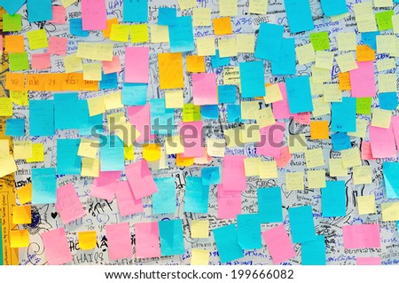 BANGKOK - JUNE 9: Colorful Post It Notes with suggestions on the walls at the Bangkok Art and Culture Center on June 9, 2014 in Bangkok, Thailand. - stock photo