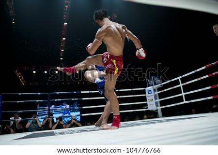 "BANGKOK - JUNE 9: Muay Thai Welterweight World Championship fight - Big Ben Ch. Praram 6 (Thailand) foot kicking Fabio Pinca (FRA) at ""BATTLE FOR THE BELTS"" event on June 9, 2012 in Bangkok, Thailand - stock photo"