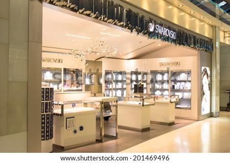 BANGKOK - JUNE 17: Swarovski store in Suvarnabhumi International Airport, Bangkok on Jun 17, 2014. Swarovski is an Austrian producer of luxury cut lead glass (crystal). - stock photo