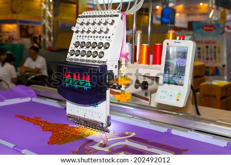 BANGKOK - JUNE 28 :Textile embroidery machine in Textile Industry at Garment Manufacturers  Sourcing 2014 on June 28,2014 in BITEC ,Bangkok, Thailand. - stock photo