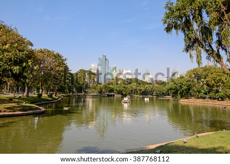 Bangkok, Limphini Park, Thailand - January 4, 2016: Lumphini Park, Lumpini or Lumpinee, park in Thailand, rare open public space, and playgrounds, with a lake where visitors can rent boats. - stock photo