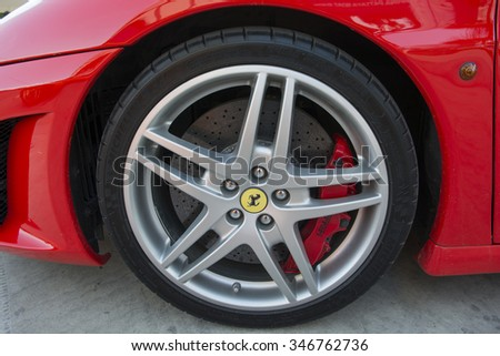 Bangkok - 03: logo of Ferrari on wheel - in display at Thailand International Motor Expo on December 03, 2015 in Bangkok Thailand