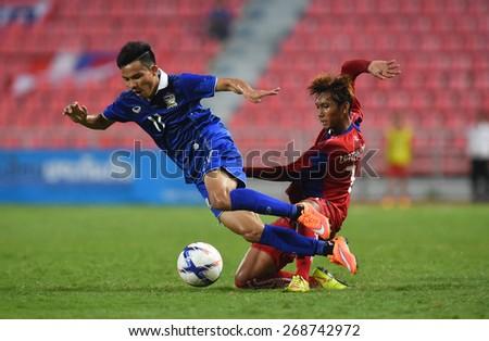 BANGKOK, MAR 27: I.PINYO(B) of Thailand in action during AFC U-23 Championship 2016 (Qualifiers) between Thailand and Cambodia at Rajamangala stadium on March 27, 2015 in Bangkok, Thailand.   - stock photo
