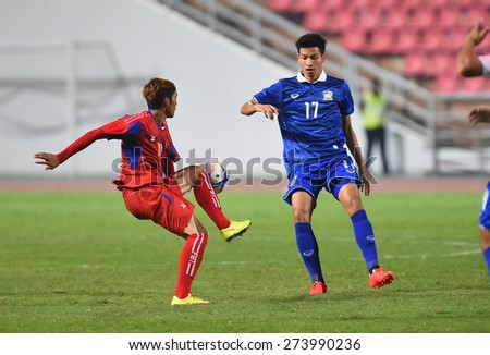 BANGKOK, MAR 27: K.TANABOON(B) of Thailand in action during AFC U-23 Championship 2016 (Qualifiers) between Thailand and Cambodia at Rajamangala stadium on March 27, 2015 in Bangkok, Thailand. - stock photo